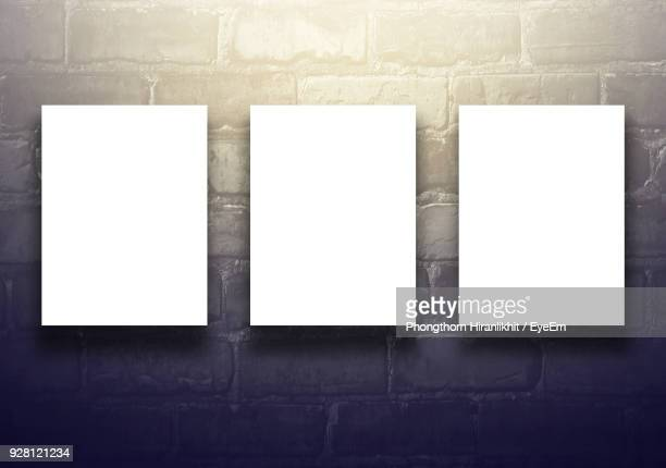 Blank Papers Against Stone Wall