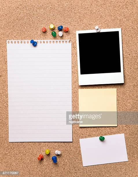 blank papers and a blank photograph on a cork board - bulletin board stock pictures, royalty-free photos & images