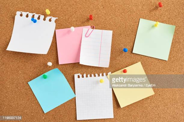 blank papers on bulletin board - bulletin board stock pictures, royalty-free photos & images