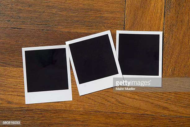Blank photo prints on wooden table