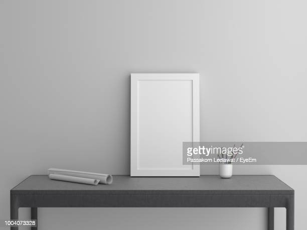 blank picture frame on table against wall - empty desk stock pictures, royalty-free photos & images