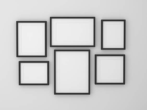 blank picture frames hanging on white wall - 攝影 個照片及圖片檔