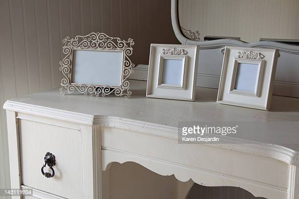 Blank picture frames on dressing table