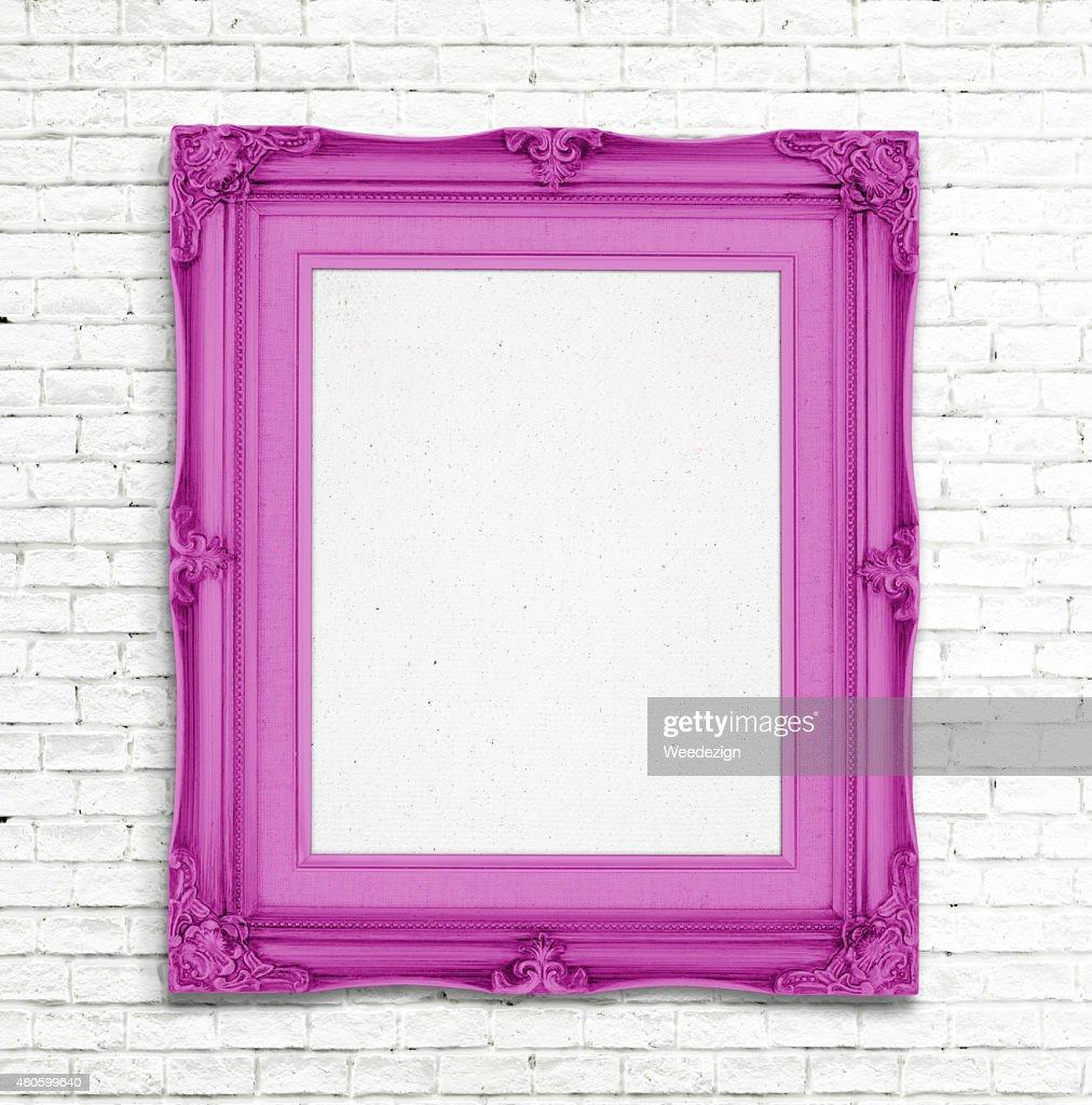 Blank pink Vintage photo frame on white brick wall : Stock Photo