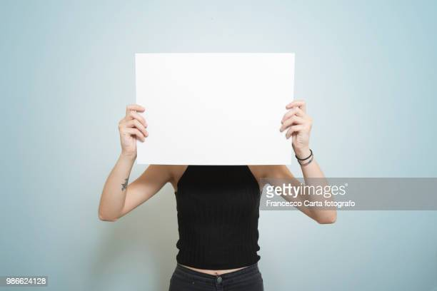 blank placard - obscured face stock pictures, royalty-free photos & images