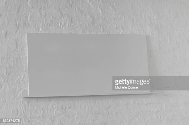 Blank plaque / name plate for an exhibition on a gallery wall, Johannesburg, South Africa.