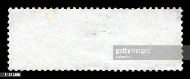 Blank postage stamp textured isolated on black background