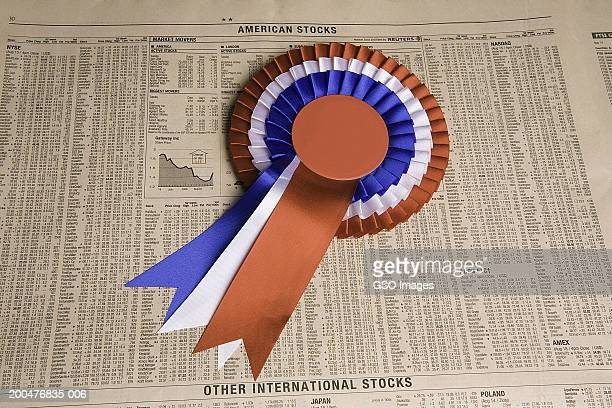 blank rosette lying on newspaper, close-up - western script stock pictures, royalty-free photos & images