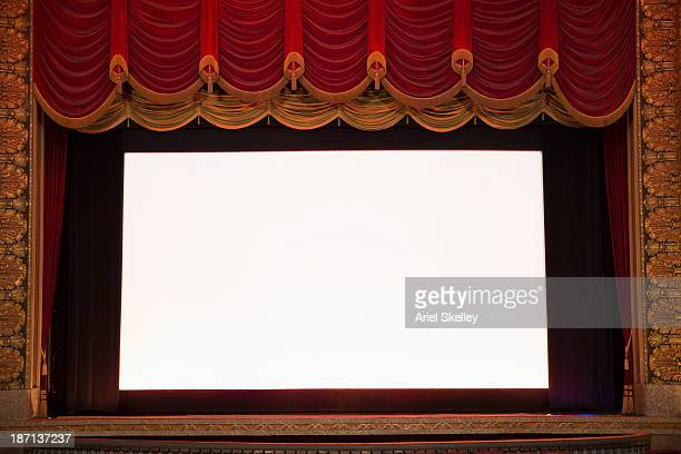 blank screen in ornate movie theater - stage curtain stock pictures, royalty-free photos & images