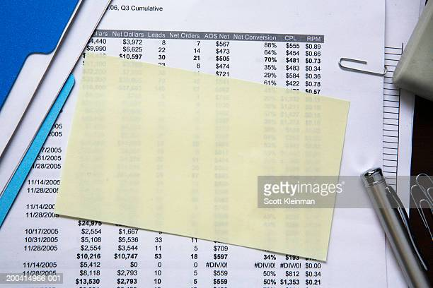 Blank self-adhesive note on spreadsheet, close-up