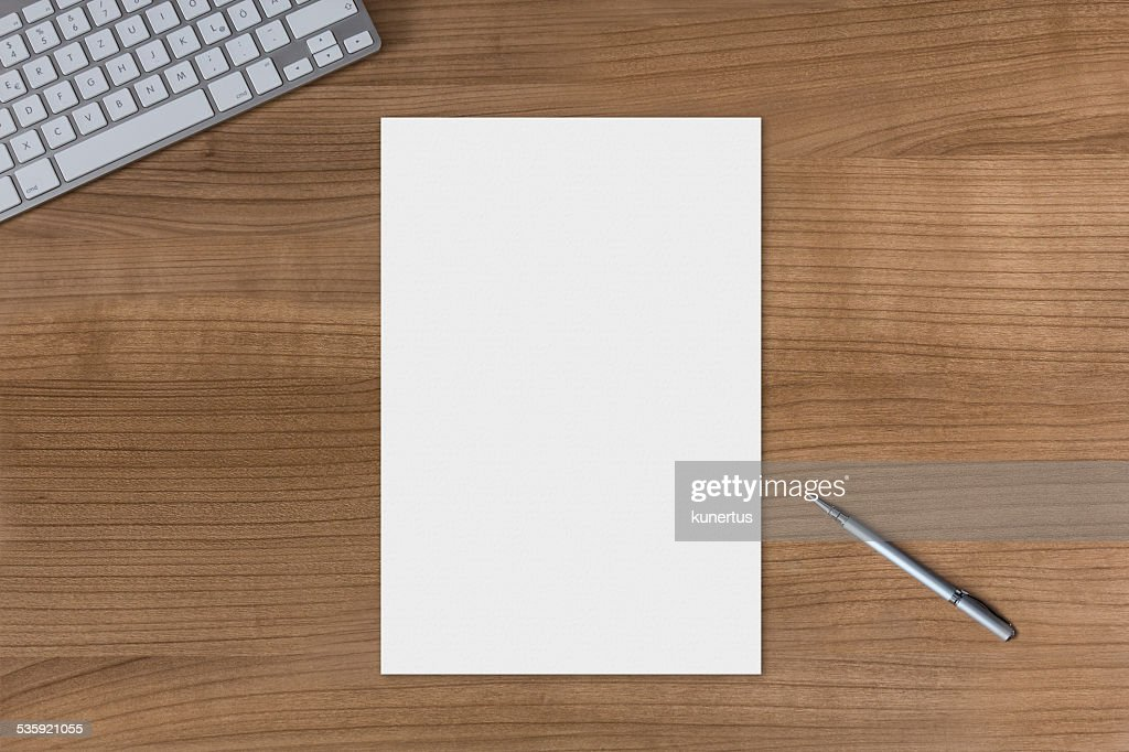Blank sheet on a wooden table : Stock Photo