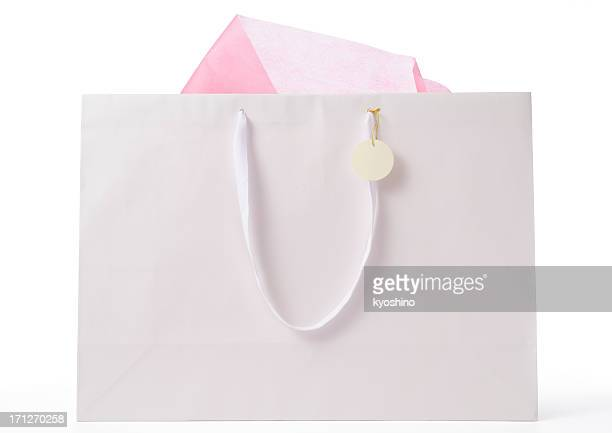 Blank shopping bag with blank tag on white background
