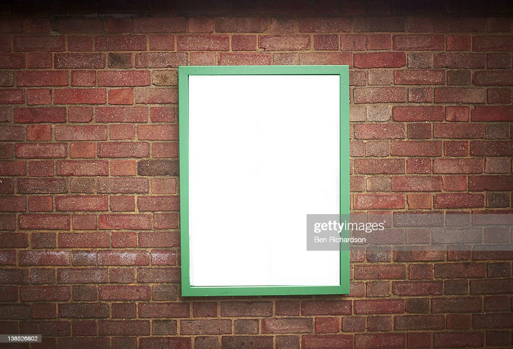 blank sign on a brick wall : Stock Photo