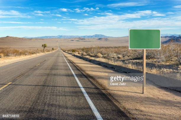 blank sign on desert highway pc rm - road sign stock pictures, royalty-free photos & images