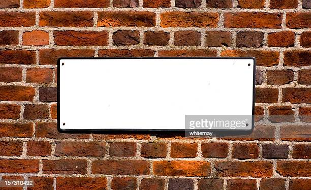 blank sign on red brick wall - nameplate stock pictures, royalty-free photos & images