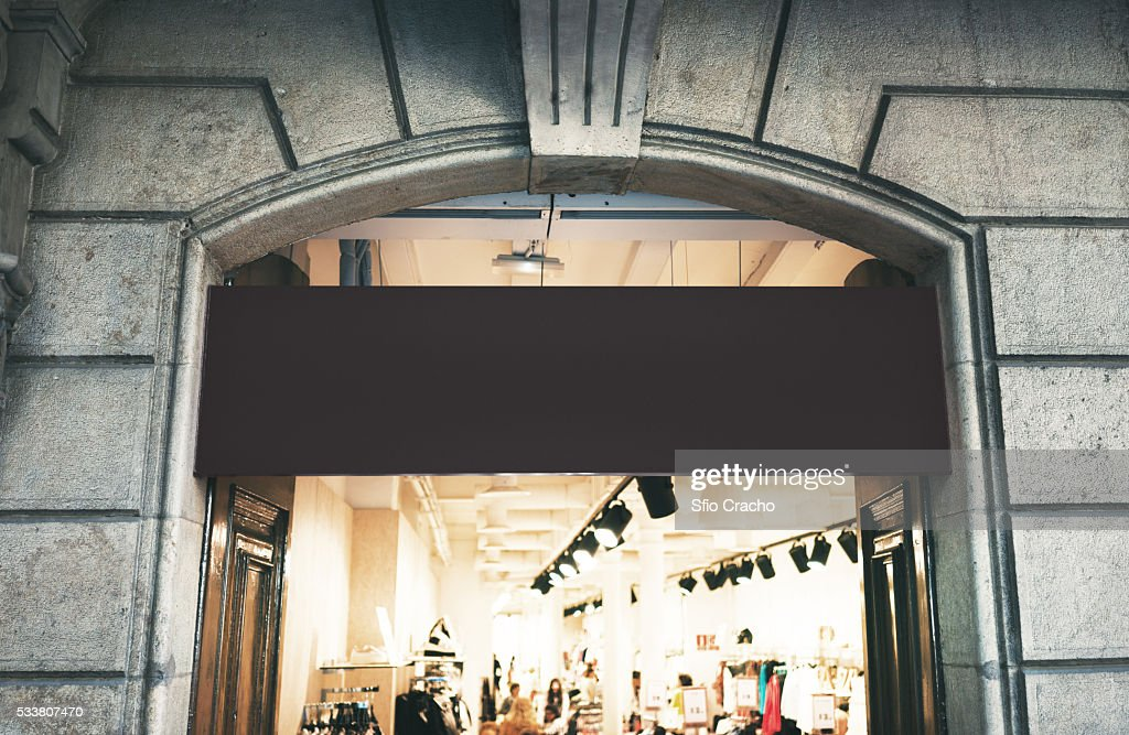 Blank signboard on a shop entrance : Foto stock