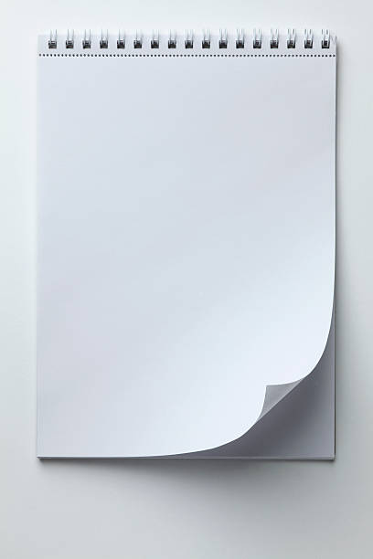 A Blank Sketch Pad With Curled Up Page Corner Wall Art