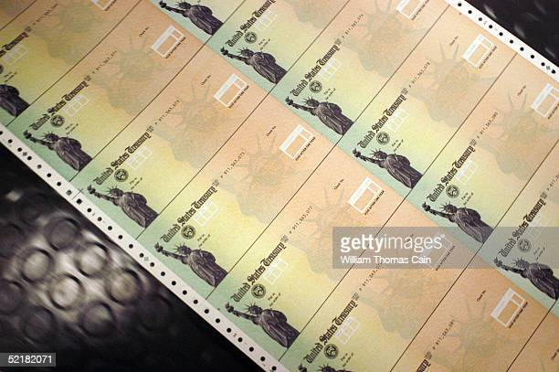Blank Social Security checks are run through a printer at the U.S. Treasury printing facility February 11, 2005 in Philadelphia, Pennsylvania. As...