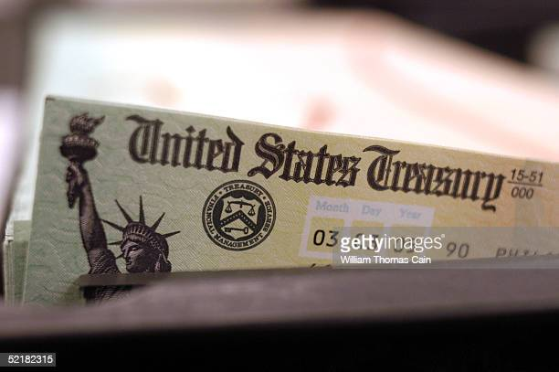 Blank Social Security checks are run through a printer at the US Treasury printing facility February 11 2005 in Philadelphia Pennsylvania As US...
