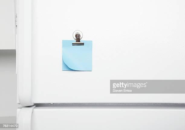 Blank sticky notes on fridge door