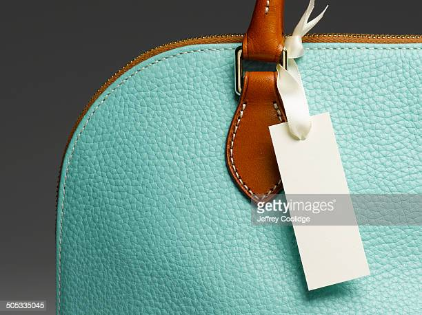 blank tag on handbag - clutch bag stock pictures, royalty-free photos & images