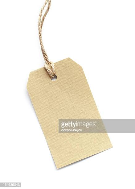 blank tag tied with brown string on white - brown jeans stock photos and pictures