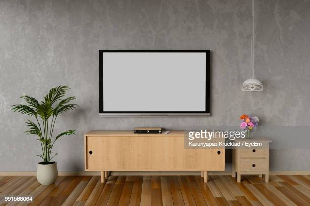 blank television set mounted on wall at home - televisión fotografías e imágenes de stock