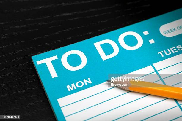 A blank To Do List with a pencil lying on it, close-up