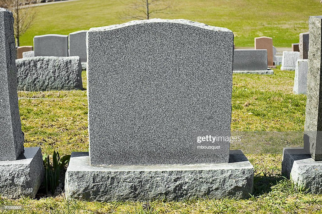 A blank tombstone in a cemetery : Stockfoto
