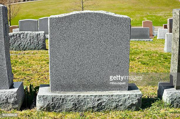 A blank tombstone in a cemetery