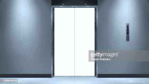 blank vertical billboard or poster on door of the elevator. - building entrance stock pictures, royalty-free photos & images