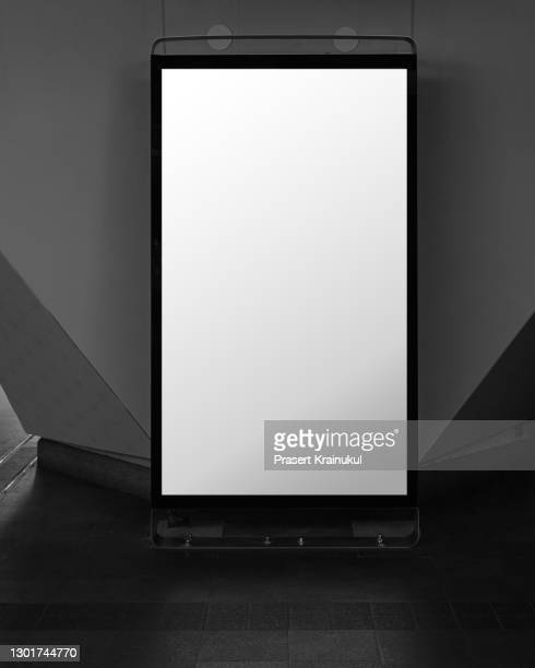 blank white banner at metro station. blank billboard in railway station, mock up - vertical stock pictures, royalty-free photos & images