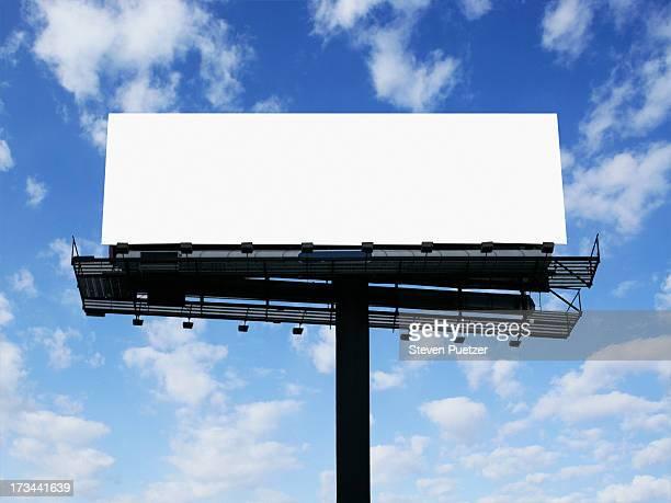 Blank white billboard against sky