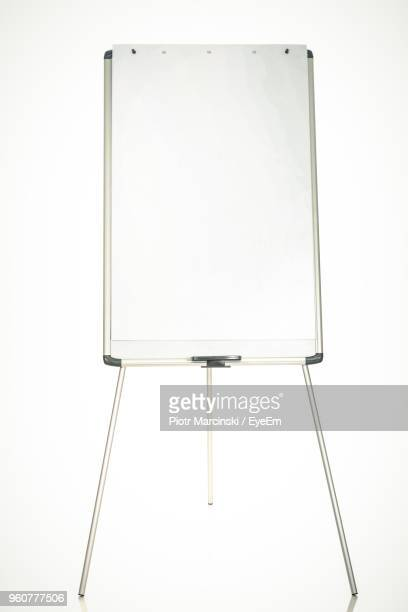 Blank White Board On Stand Against White Background