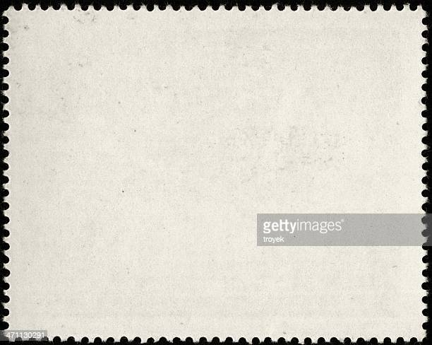 Blank white postage stamp with serrated edges