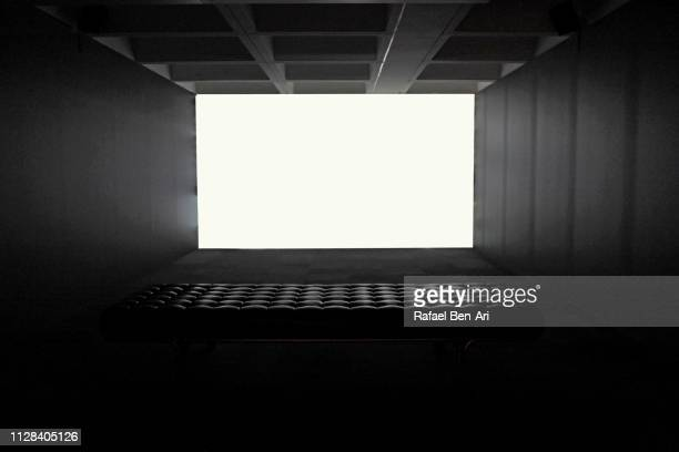 blank white screen in an empty concrete room - rafael ben ari stock pictures, royalty-free photos & images