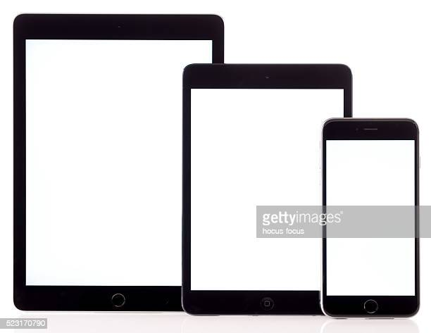 Blank white screen iPad tablet computers and iPhone 6 Plus