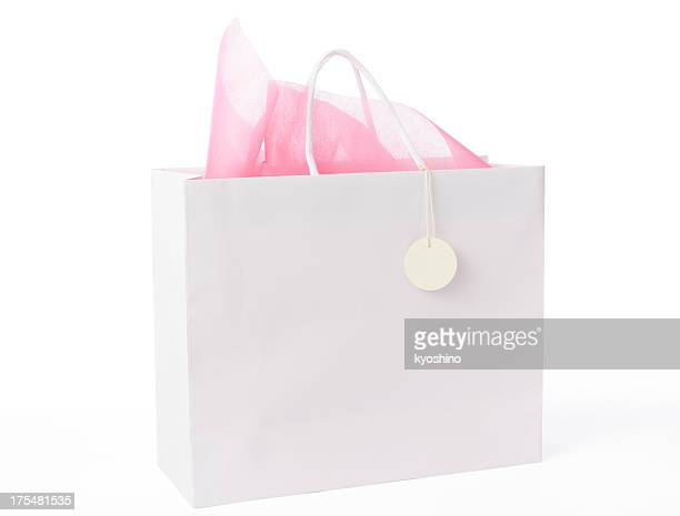Blank white shopping bag with blank tag on white background