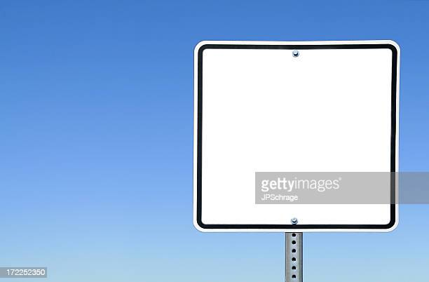 Blank White Sign Against the Clear Blue Sky