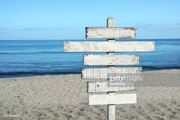 Blank wood sign at the beach
