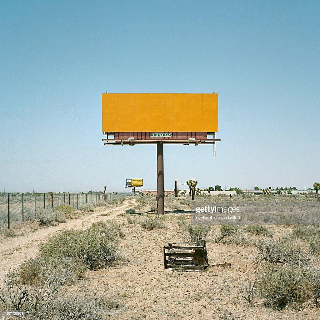 Blank yellow billboard : Stock Photo