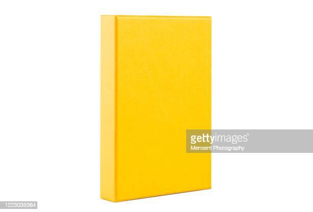 blank yellow box template isolated over white background - livro imagens e fotografias de stock