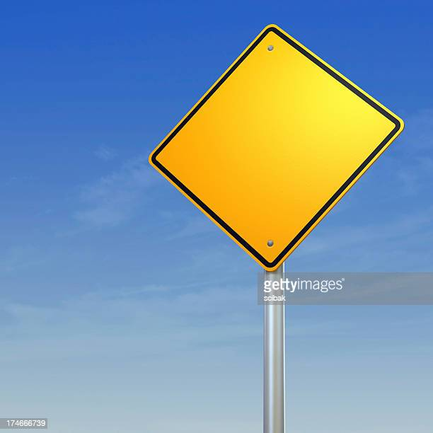 Blank yellow diamond warning sign against a blue sky