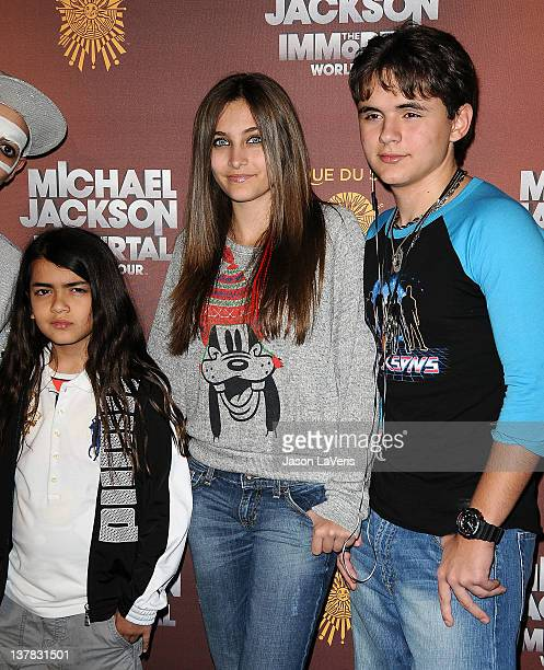 """Blanket Jackson, Paris Jackson and Prince Michael Jackson attend the Los Angeles opening of """"Michael Jackson THE IMMORTAL World Tour"""" at Staples..."""