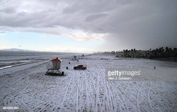 BEACH CA MARCH 2 2015 A blanket of hail covers the beach justing north of the Huntington Beach pier Monday March 2 2015