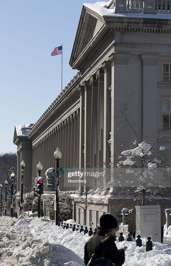 A blanket of snow covers the U.S. Treasury building in Washington, D.C., U.S. on Monday, Feb. 8, 2010. A new storm system barreling across the country may bring as much as 12 inches (30 centimeters) of snow to New York, Washington and Baltimore starting late tomorrow, forecasters said. Photographer: Andrew Harrer/Bloomberg via Getty Images