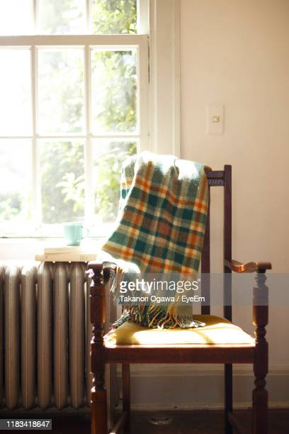 blanket on chair at home - 毛布 ストックフォトと画像