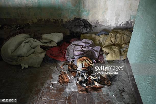 Blankets and old clothes found on the floor of an abandoned house previously occupied by gangs and recovered by the police during Operation Phoenix...