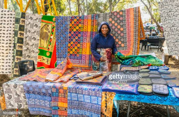 blankets and sheets with african designs at irene market - pretoria stock pictures, royalty-free photos & images