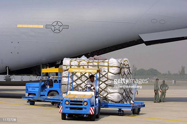Blankets donated from USAID are unloaded from a US Air Force C-17 cargo plane October 23, 2001 at Chaklala Air Force Base near Rawalpindi, Pakistan....